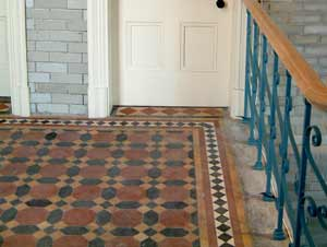 Quarry tiles on the landing after restoration. Photo by Careww-Cox.